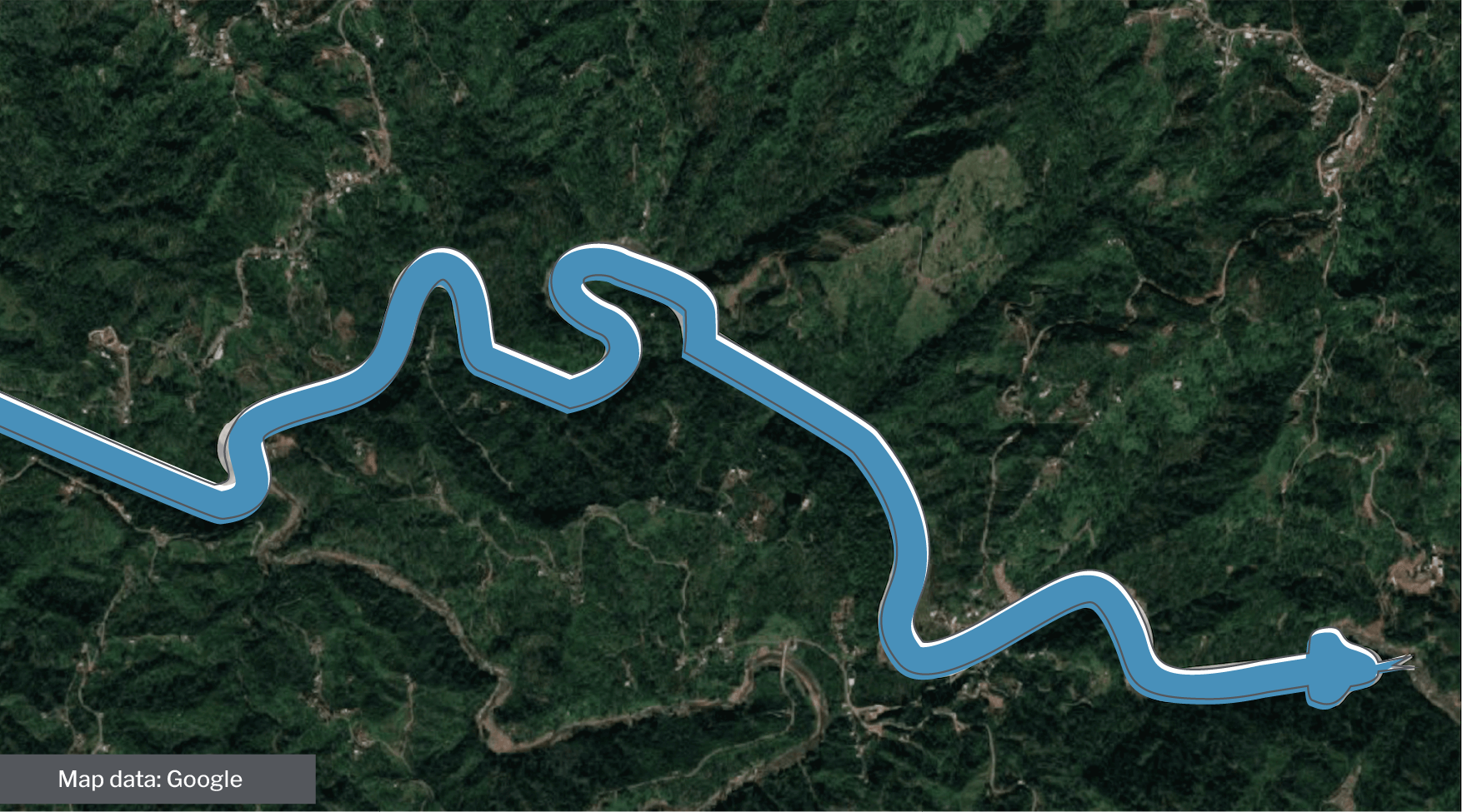 Graphical drawing of a snake overlaid on a Google map image of a mountainous Puerto Rican terrain.